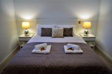 Habitación con cama doble en apartamento en la zona turística de Funchal